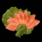Salmon sashimi on green salad